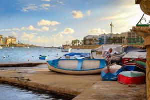Marsaskala Harbor boats and fisherman