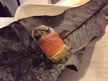 A perfect parcel: Salmon and salmon roe in a magnolia leaf © Kaori Mahajan for WhereNYC