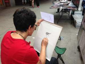 Artist #2 drawing the Girl on Fire