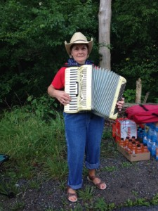 Accordion player at water stop
