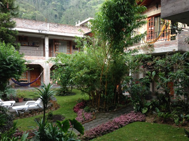 The courtyard of our hotel in Banos - lush and beautiful, with mountains rising up behind it.
