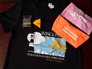 The Wisconsin Marathon 2015 tech shirt, free bondi bands, free jelly bean sample, and (purchased) cheese pin.