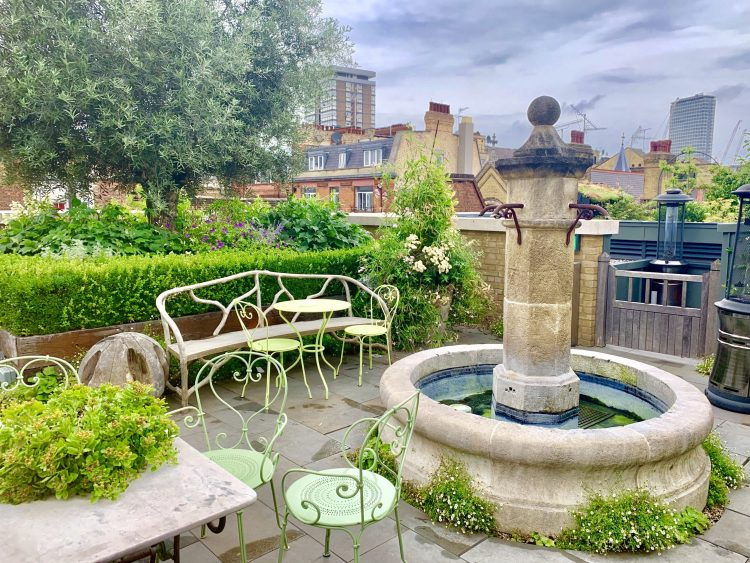 Stone fountain and garden furniture on Ham Yard rooftop
