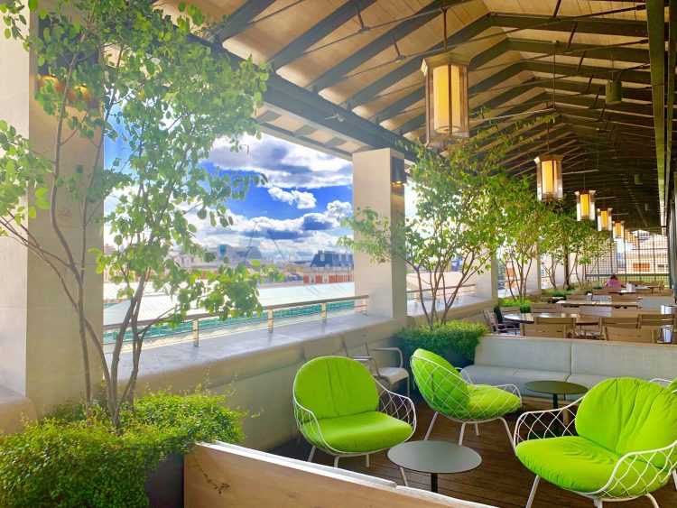 green sofa chairs by the rooftop