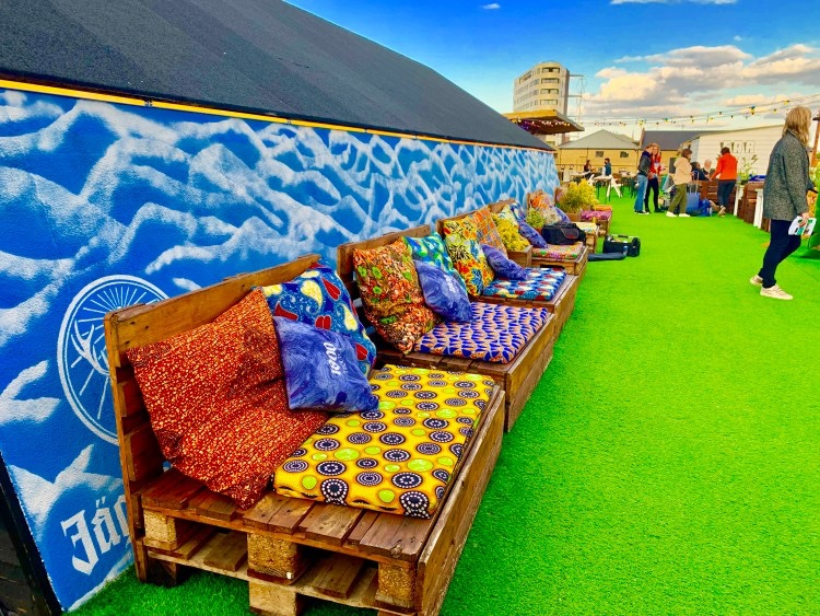 Colourful chairs and sofas on rooftop bar in Dalston