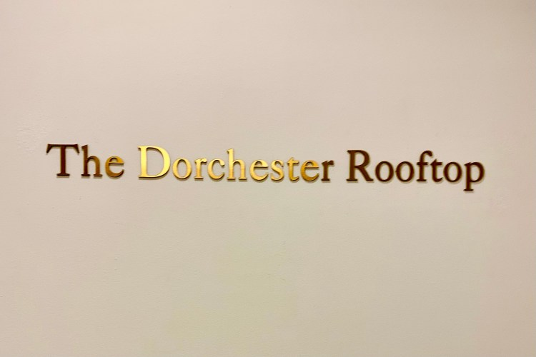 Dorchester hotel rooftop bar sign