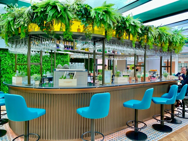 Foliage rooftop bar with green stools