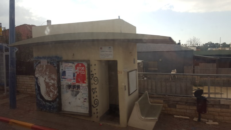 One of the bus stops in Sderot. With a bomb shelters right next to it.
