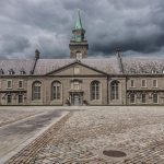 view of the courtyard of the Irish Museum of Modern Art. Cobblestones and large square plaza