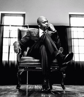 Dave Chappelle in a suit