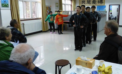 Xian. Singing and dancing with lovely young people. More eating and preparing for transit.