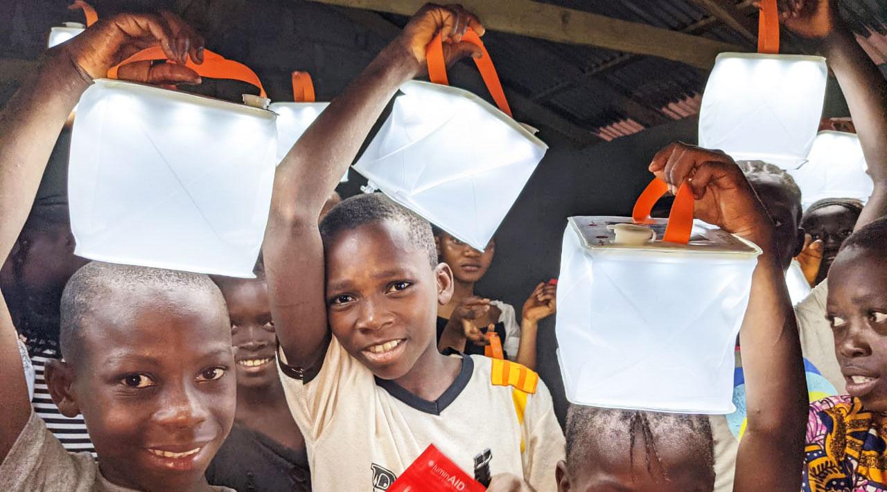 Children holding solar-powered lanterns