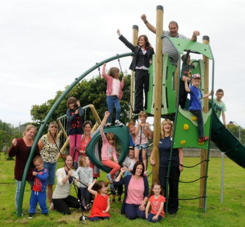 Image of Whicham parish council team playing with childrens in Kirksanton play area