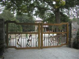 wood, steel, copper and stained glass entry gates