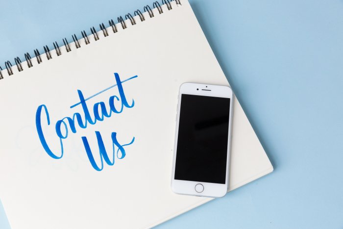 a-phone-on-a-blue-background-with-contact-us