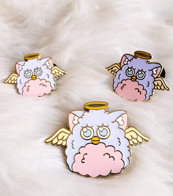 Furby enaml pin with an angel halo and cute eyes