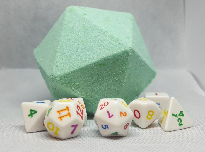 A large 10 sided dice made of soap in light green with a set of colorful dice around it
