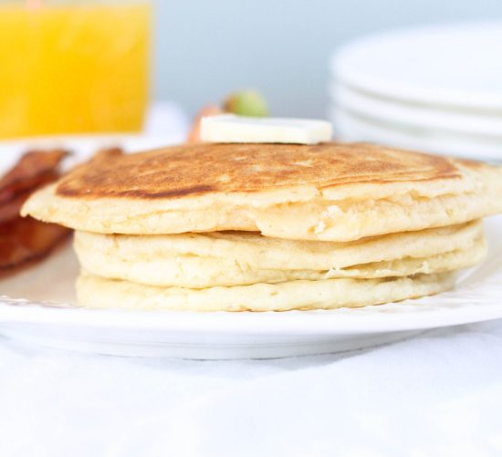 Pancakes from Scratch Recipe: You'll never make pancakes from a box again after trying this recipe. It's quick, easy, and requires ingredients you likely already have in your pantry. They're quick, easy, dense, slightly fluffy in the just the right way, and just the very best recipe.