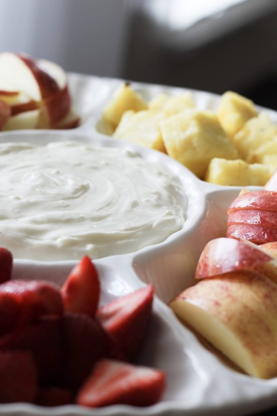 This easy peasy two-ingredient fruit dip recipe takes just a couple minutes to whip together and is sure to be a hit at your next shower, barbecue, or even as a sweet treat you keep in the refrigerator all to yourself. It combines marshmallow fluff or marshmallow creme and a bar of cream cheese. It's versatile and could be enhanced with chocolate, caramel, or other flavorings like strawberry, lemon, or blueberry. Even add food coloring! Apples, strawberries, pineapple, and other fruits are all perfect dippers for this delicious dip. Full recipe on Whimsical September blog.