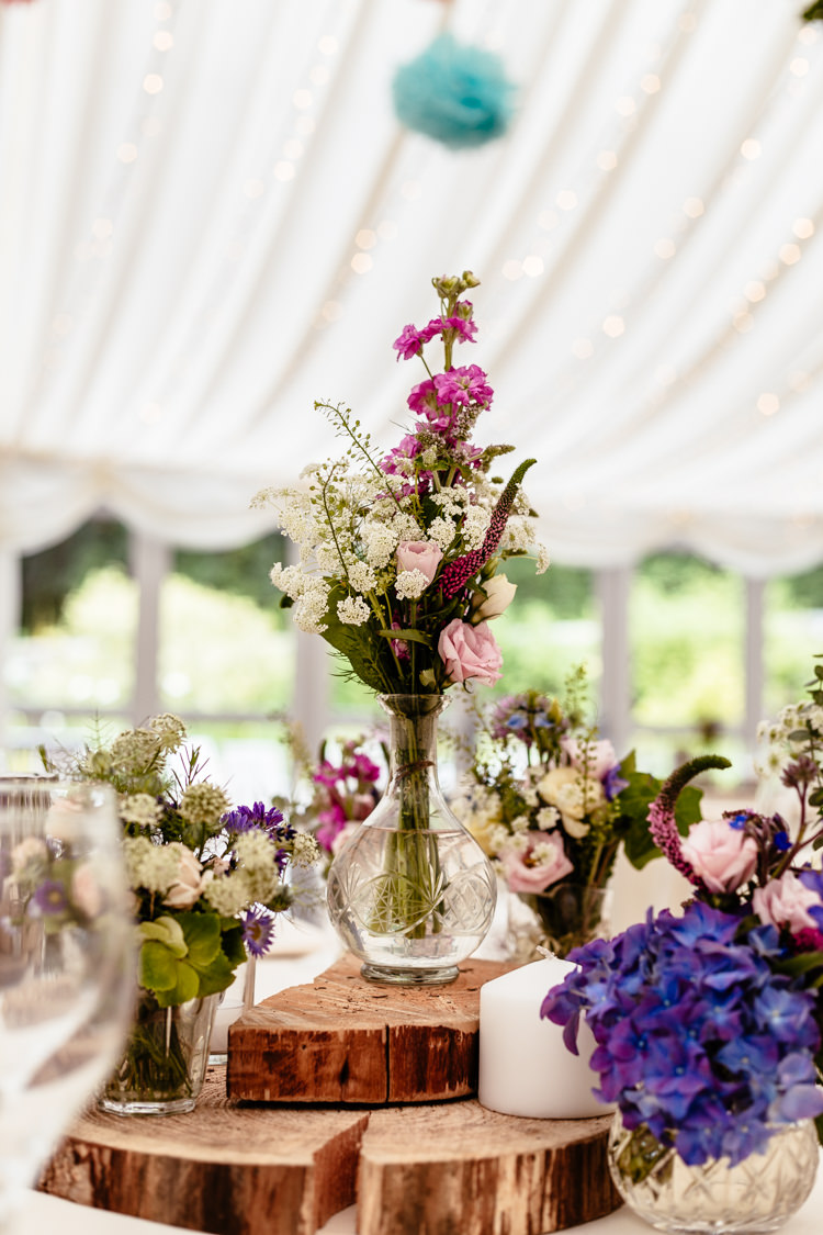 Flowers Vases Log Centrepieces Tables Quirky Colourful Pastel Country Fair Wedding http://www.cassandralane.co.uk/