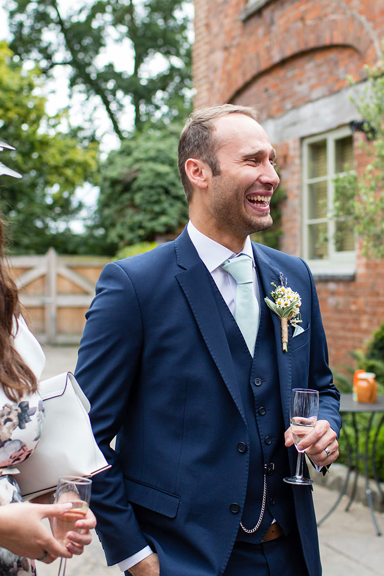 Navy Suit Groom Pretty Natural Floral Barn Wedding http://www.johastingsphotography.co.uk/