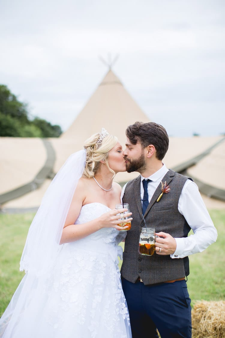 Jar Drinks Tipi Pimms Bride Groom Family Farm Festival Wedding https://amylouphotography.co.uk/