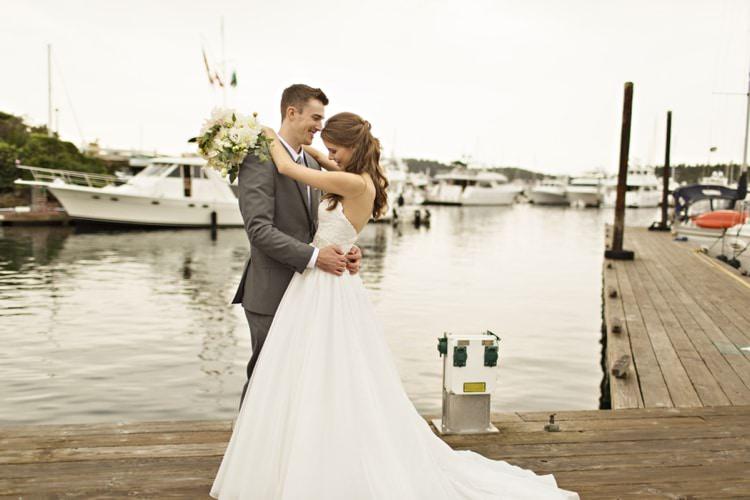 Bride Groom Roche Harbor Resort Marina Strapless Sweetheart Bridal Gown Dahlia Bouquet Groom Grey Suit Elegant Classic Outdoor Wedding Washington http://www.courtneybowlden.com/