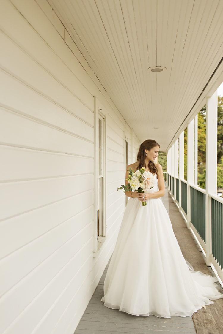 Bride Strapless Sweetheart Bridal Gown Bouquet Peach Pink Dahlia Elegant Classic Outdoor Wedding Washington http://www.courtneybowlden.com/