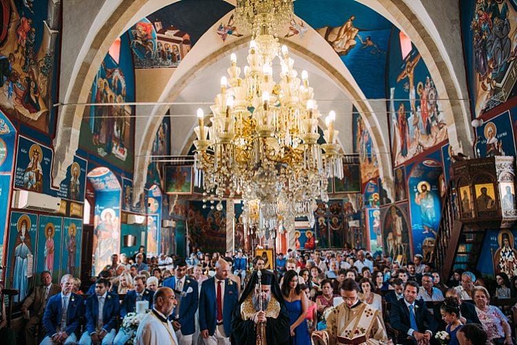 Church Ceremony Chandelier Groom Groomsmen Guests Beautiful Traditional Greek Destination Wedding in Cyprus http://www.jonnybarratt.com/
