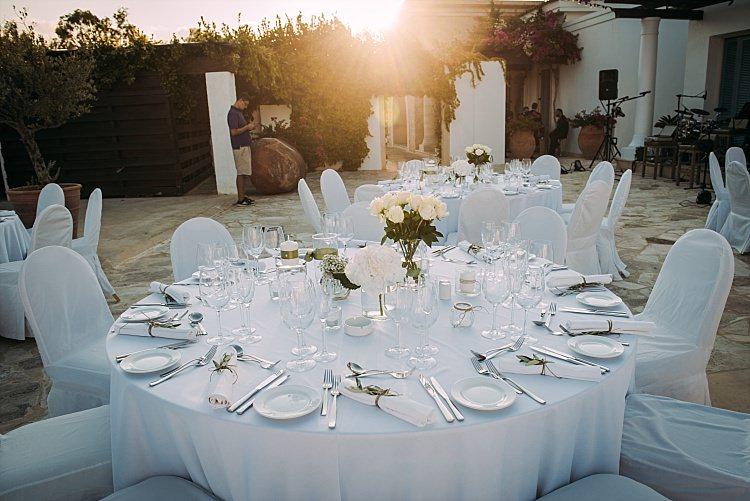 White Table Flowers Outdoor Reception Anassa Hotel Beautiful Traditional Greek Destination Wedding in Cyprus http://www.jonnybarratt.com/