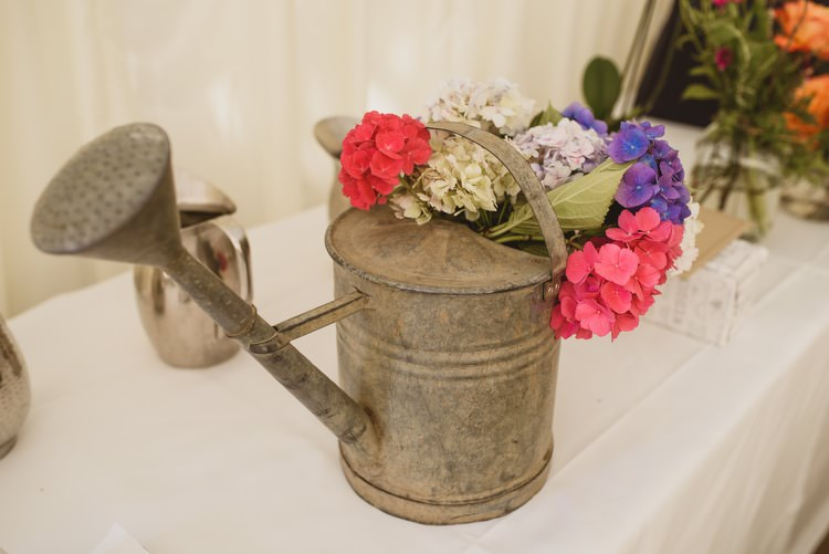 Watering Can Flowers Crafty Botanical Natural Wedding http://www.jacksonandcophotography.com/