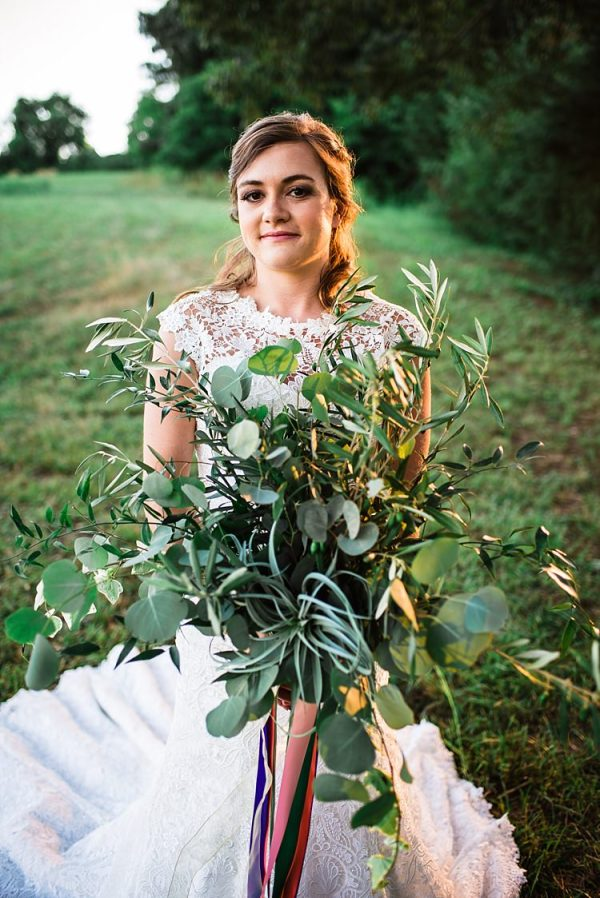 Bride Lace Cap Sleeve Wedding Gown Bouquet Greenery Leaves Multicoloured Ribbons Outdoors Ethereal Boho Wedding Ideas http://perfectcapturephoto.com/