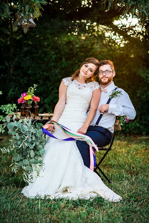 Bride Lace Bridal Gown With Buttons Greenery Bouquet Multicoloured Ribbons Groom Navy Pants Suspenders Cream Bow Tie Buttonhole Table Colourful Florals Brown Glass Vases Trees Grass Ethereal Boho Wedding Ideas http://perfectcapturephoto.com/
