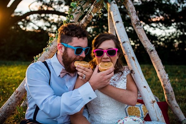 Bride Lace Bridal Gown With Buttons Groom Navy Pants Suspenders Cream Bow Tie His And Her Pink Blue Sunglasses Donuts Teepee Grass Trees Ethereal Boho Wedding Ideas http://perfectcapturephoto.com/