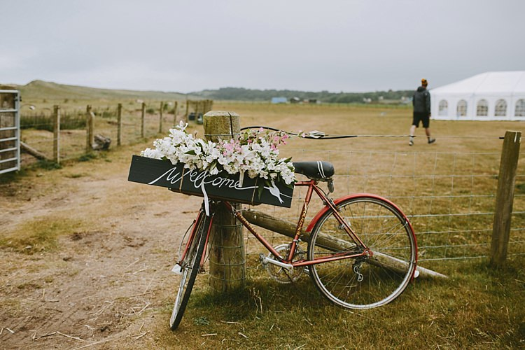 Bicycle Bike Flowers Sign Beautiful Bohemian Beach Glamping Wedding http://www.thecurries.co/