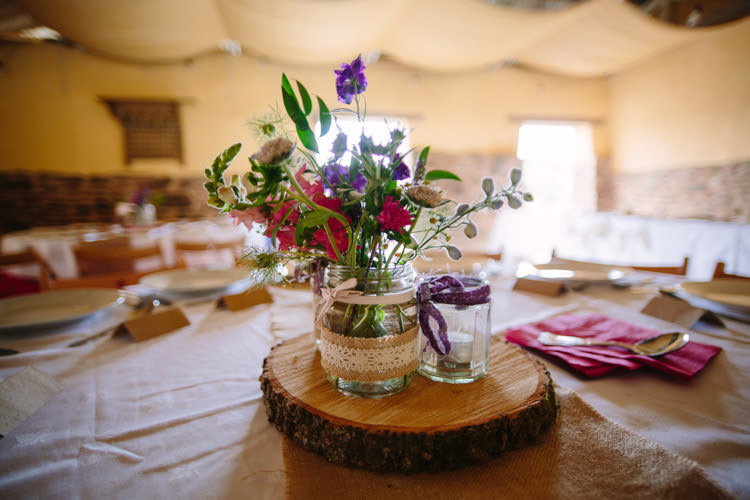 Jar Flowers Lace Hessian Log Centrepiece Mismatched Berry DIY Wedding http://www.colinianross.com/