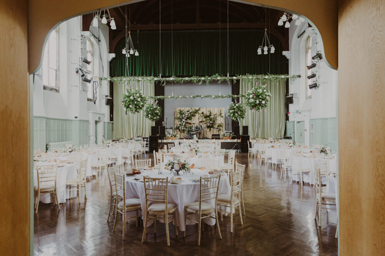 Flower Bombs Pallet Backdrop Hall Brighton College Romantic Stylish Relaxed Sea Wedding http://www.oxiphotography.co.uk/