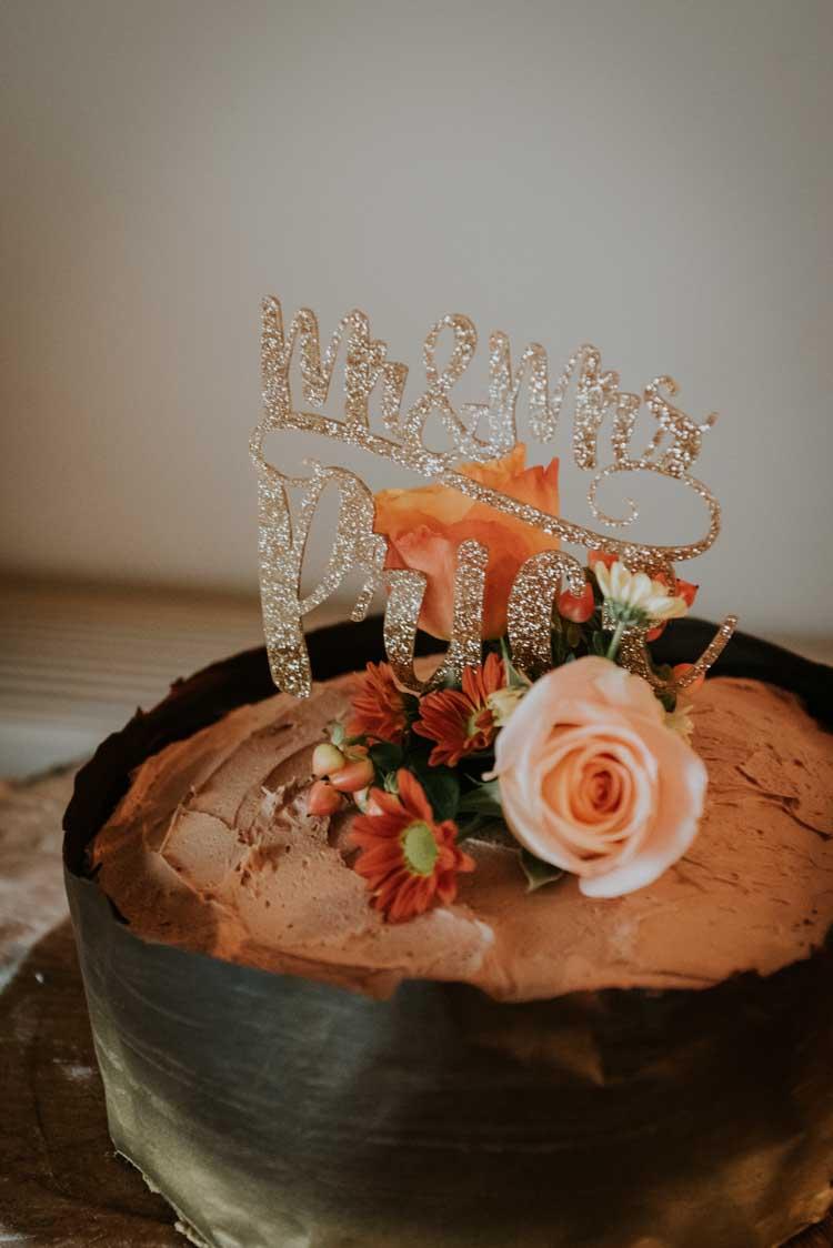 Chocolate Cake Glitter Toppper Names Rose Gold Autumn Barn Wedding http://www.weddingphotographyincheltenham.co.uk/