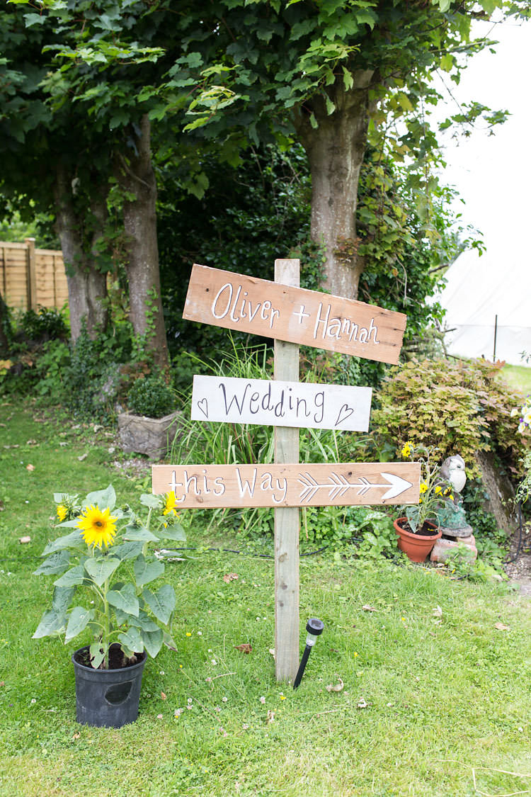 Wooden Sign Post Painted Summer Sunflowers Marquee Wedding http://maddiewaters.co.uk/