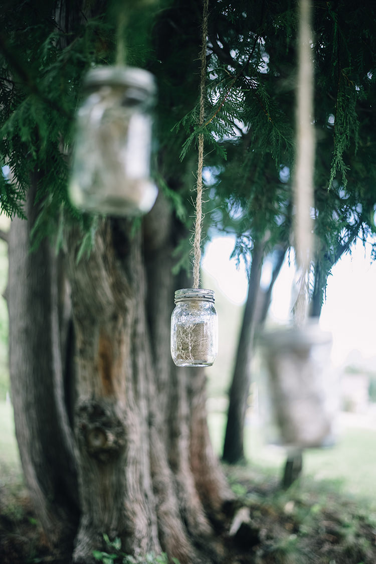 Outdoor Ceremony Hanging Décor Mason Jars Delicate Plants Tall Leafy Tree Woodland Waterfall Mint Wedding Ontario http://www.laurenmccormickphotography.com/