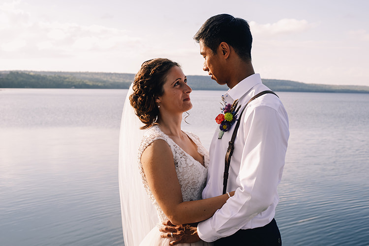 Bride Allure Champagne Lace Tulle Bridal Gown Long Veil Pearl Earrings Groom White Shirt Brown Leather Suspenders Navy Pants Multicoloured Floral Buttonhole Woodland Waterfall Mint Wedding Ontario http://www.laurenmccormickphotography.com/
