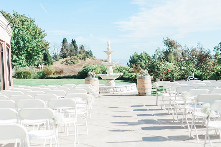 Outdoor Ceremony Grand Water Fountain White Chairs Barrel Tables Florals Grass Trees Soft Blush Sage Green Wedding California http://julia-rosephotography.com/