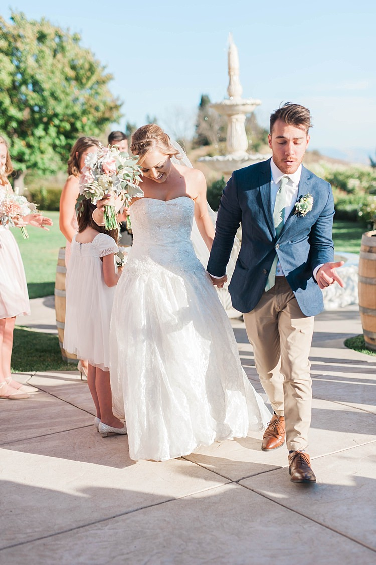 Outdoor Ceremony Bride Lace Sweetheart Strapless Bridal Gown Veil Bouquet Groom Navy Jacket Beige Pants Light Green Tie Bridesmaids Water Fountain Soft Blush Sage Green Wedding California http://julia-rosephotography.com/