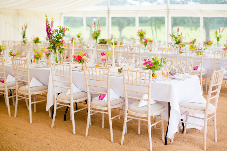 Flowers Long Tables Marquee Colourful Pastel Home Made Farm Wedding http://helencawtephotography.com/