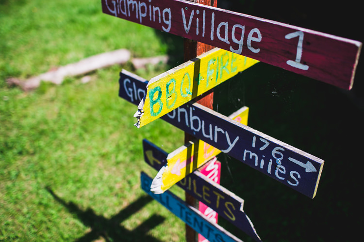 Wooden Painted Sign Post Fun Festival Glamping Wedding https://storry.co.uk/