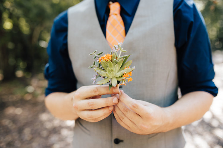 Groom Grey Vest Navy Blue Shirt Orange Checkered Tie Buttonhole Orange Florals Succulent Greenery Adventure Inspired Woodland Wedding North Carolina http://www.amandasuttonphotography.com/