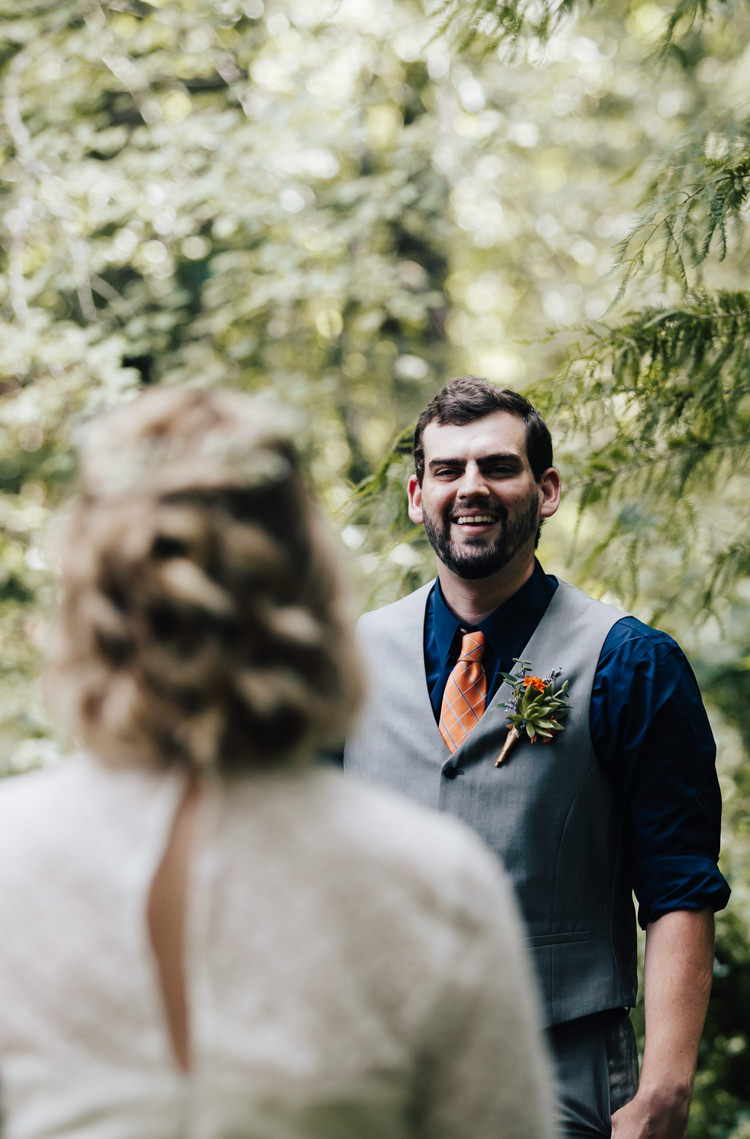 Outdoor First Look Bride Handmade Lace Bridal Gown Groom Grey Vest Pants Navy Blue Shirt Orange Checkered Tie Buttonhole Orange Florals Succulent Adventure Inspired Woodland Wedding North Carolina http://www.amandasuttonphotography.com/