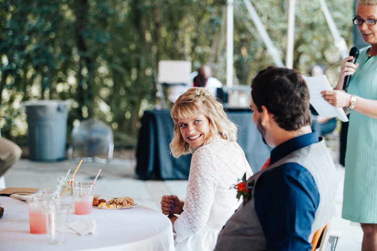 Reception Speeches Bride Handmade Lace Bridal Gown Groom Grey Vest Navy Blue Shirt Buttonhole Orange Florals Succulent Adventure Inspired Woodland Wedding North Carolina http://www.amandasuttonphotography.com/