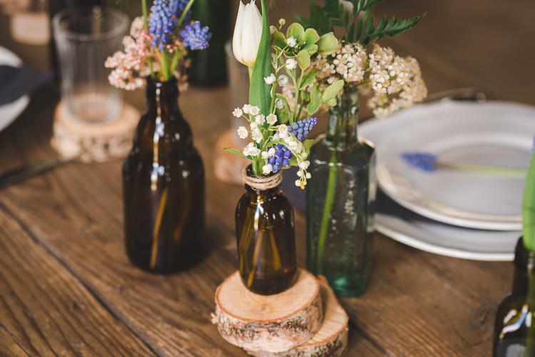 Brown Bottle Flowers Log Decor Magical Spring Bluebell Woodland Wedding Ideas http://helinebekker.co.uk/