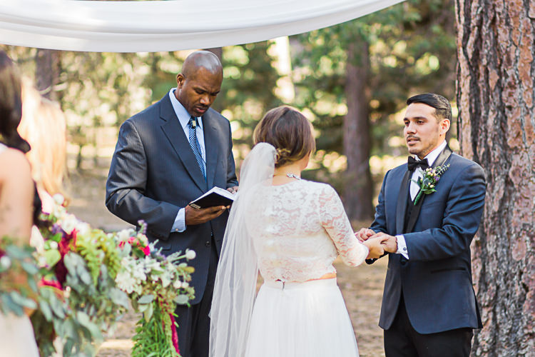 Outdoor Ceremony Bride Watters Separates Lace Top Tulle Skirt Veil Cascading Multicoloured Bouquet Father Groom Dark Blue Jacket Black Satin Lapel Black Pants Bowtie Celebrant DIY Whimsical Camp Wedding California http://www.landbphotography.org/